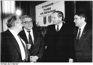 Photo: Symposium Frieden und Abrüstung, Dresden 1988, by Ulrich Häßler, Bundesarchiv, 183-1988-0318-312, CC-BY-SA 3.0 (https://commons.wikimedia.org/wiki/File:Bundesarchiv_Bild_183-1988-0318-312,_Dresden,_Symposium,_Wolfgang_Berghofer.jpg)